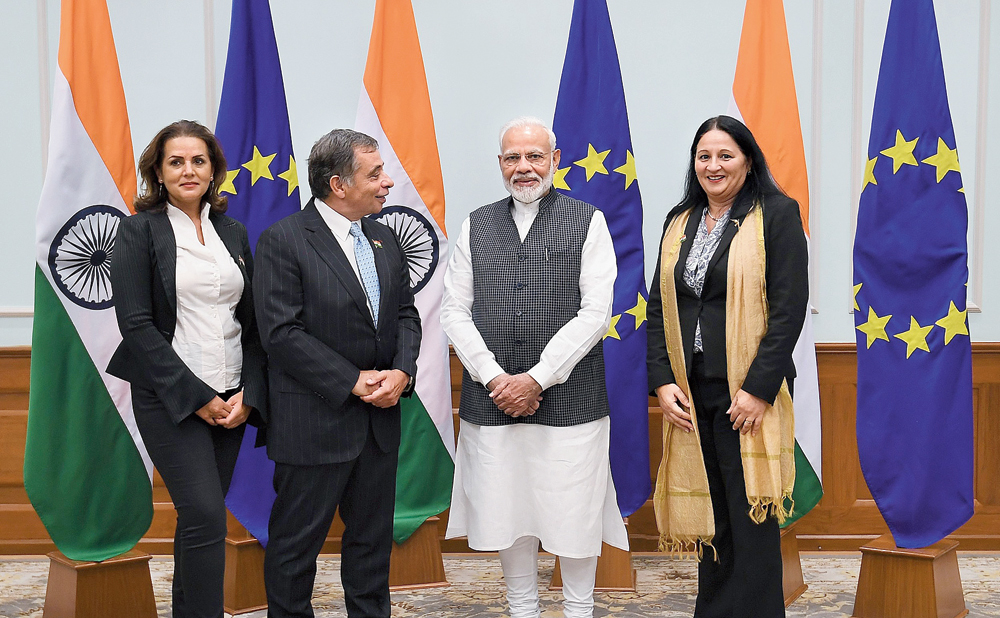 "A Press Information Bureau picture shows Narendra Modi with what the PIB identified as ""the Members of European Parliament"" in New Delhi on Monday at 7 Lok Kalyan Marg, New Delhi. 7 Lok Kalyan Marg is the official residence of Prime Minister Modi. On the extreme right is Madi Sharma."