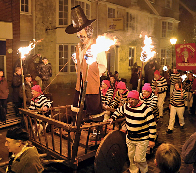 Bonfire societies parade through the streets with Guy Fawkes effigy during the Bonfire Night celebrations on November 5, 2012 in Lewes, Sussex in England