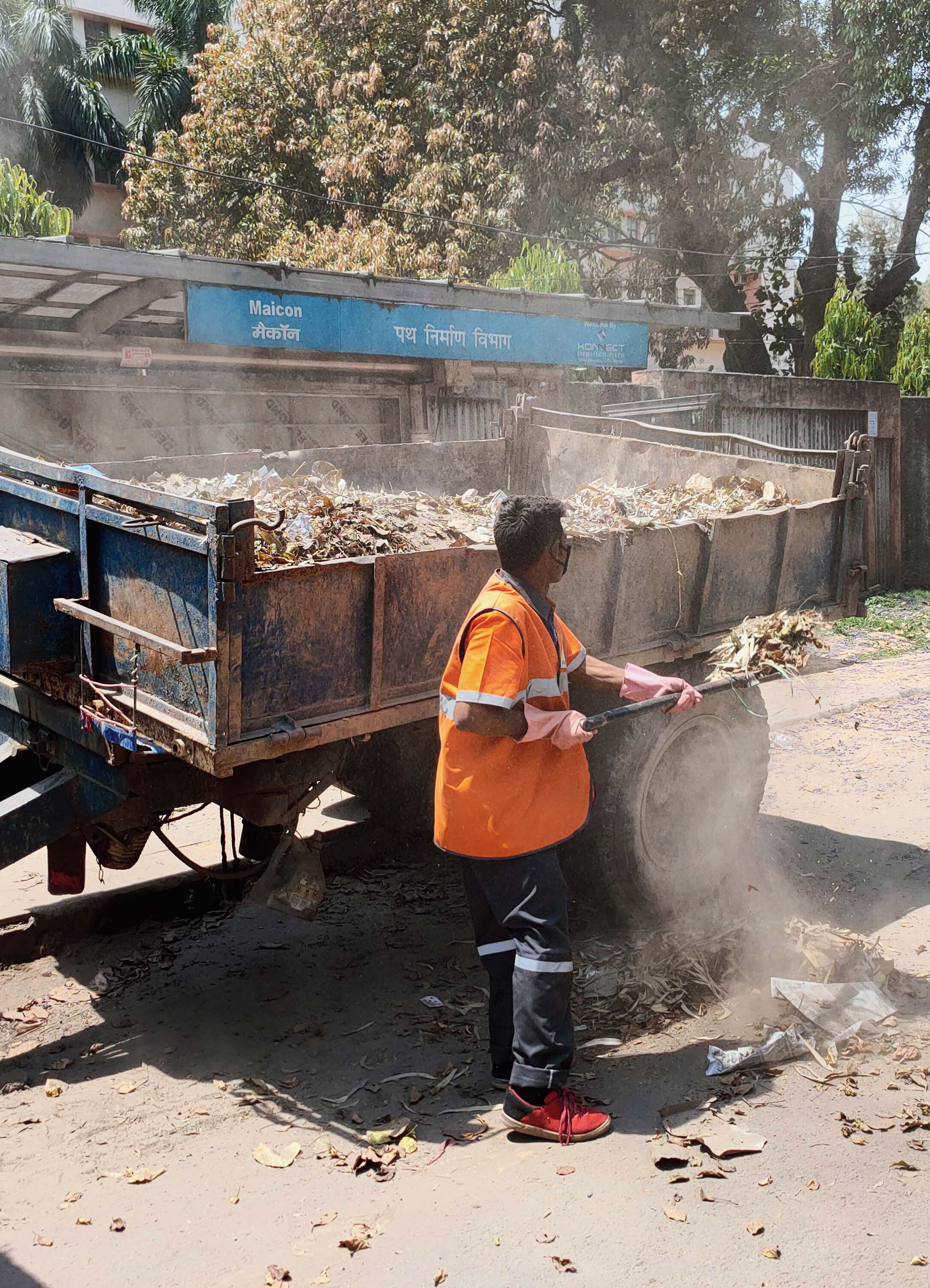An RMC worker cleans the street at Doranda, Ranchi, on Wednesday.