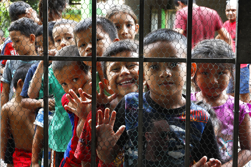 Migrant children line up for a meal at the door of a shelter at Tapachula in the Chiapas state of Mexico on May 30.