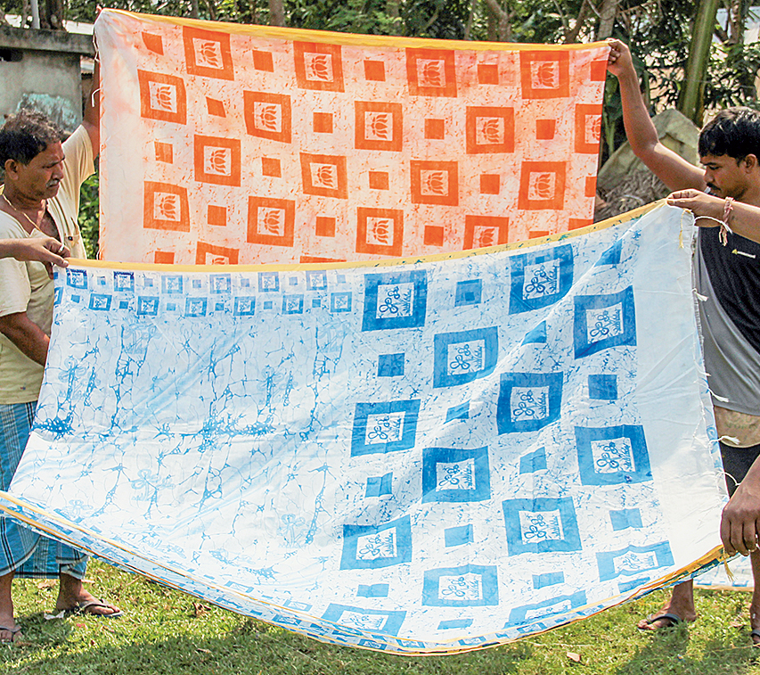 Saris with Trinamul and BJP symbols in Nadia's Santipur.