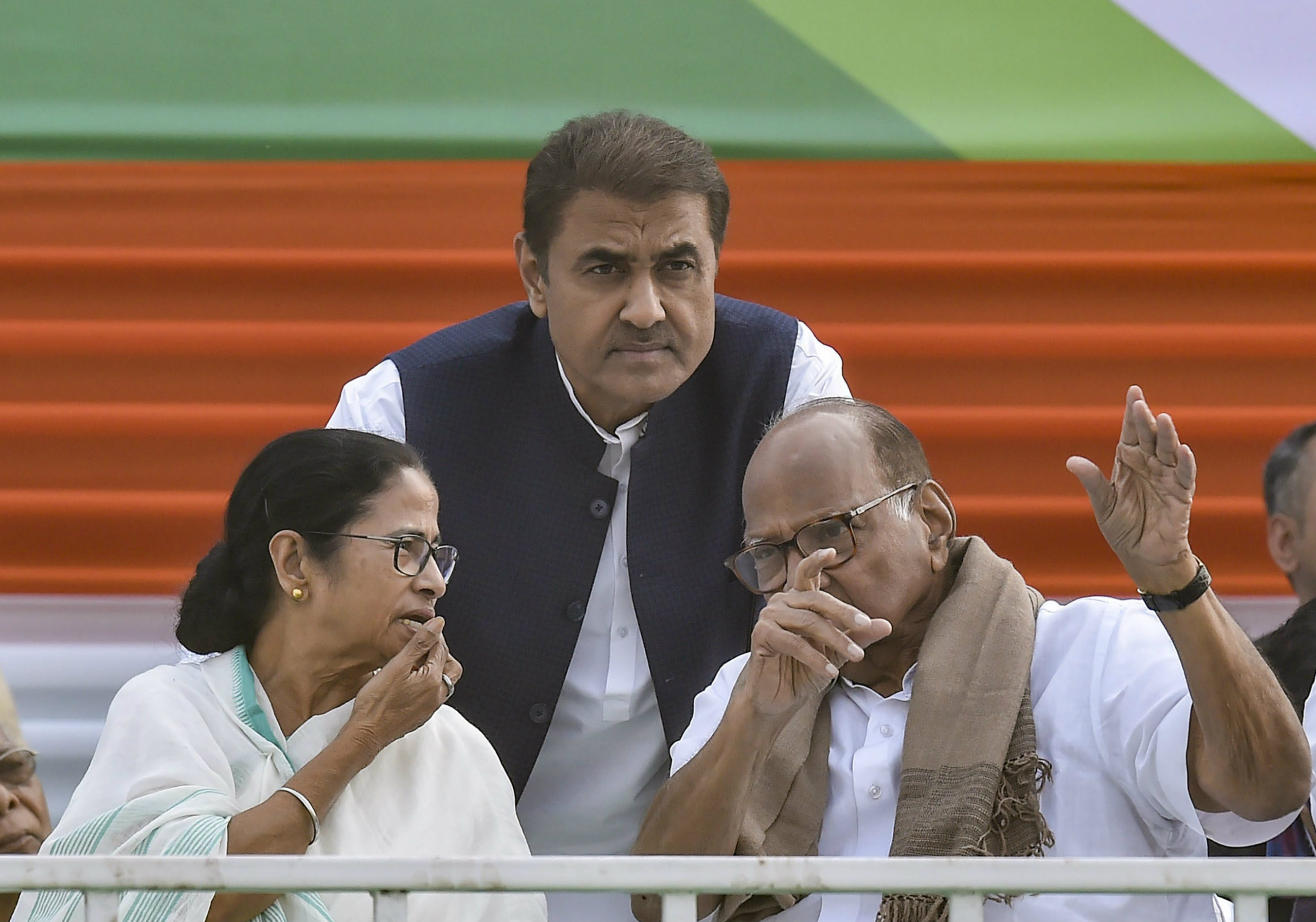 Mamata Banerjee with the NCP's Sharad Pawar (right) and Praful Patel at the rally in Calcutta on Saturday.