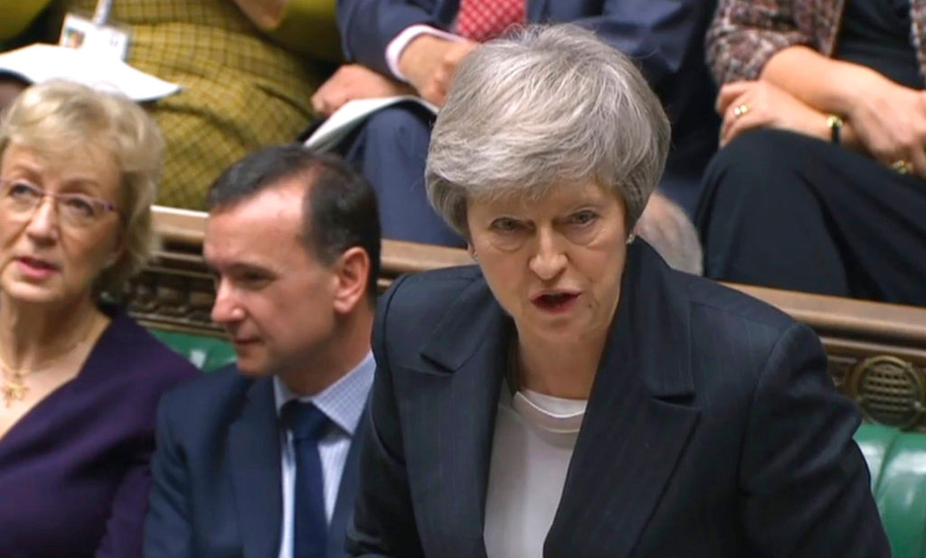Theresa May speaks during the scheduled Prime Minister's Questions time in the House of Commons, in London, on Wednesday.
