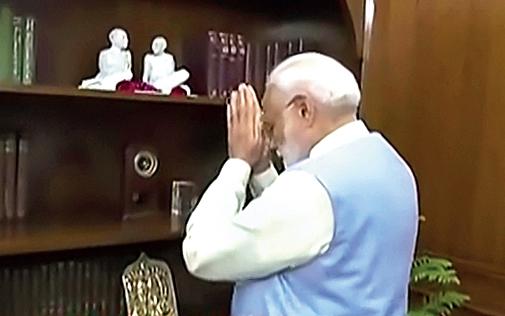 Narendra Modi offers tributes to Mahatma Gandhi and Sardar Vallabhbhai Patel in New Delhi on Friday.