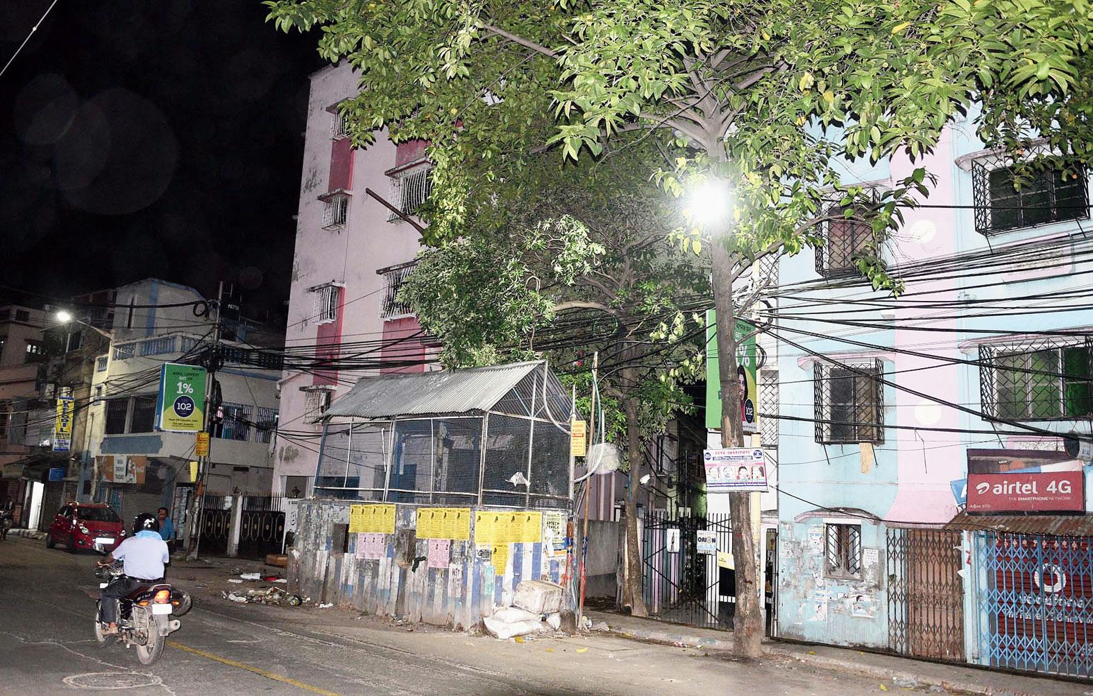 Street lights shine bright outside Rabin Datta's house in Behala on Thursday evening.