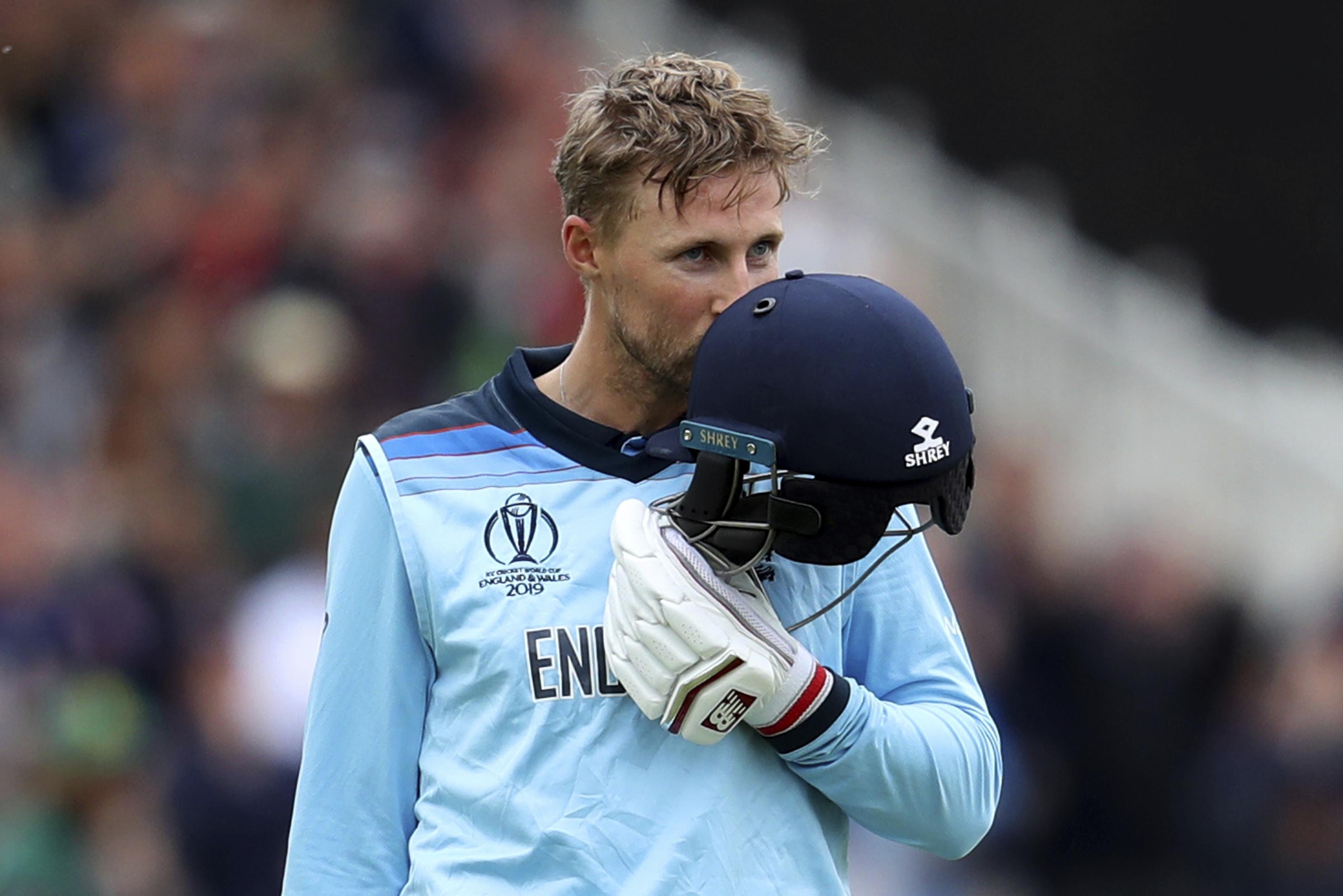 England's Joe Root kisses his helmet after scoring a century against Pakistan at Trent Bridge on June 3.