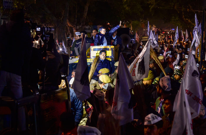 Delhi Chief Minister Arvind Kejriwal during an election campaign roadshow ahead of Delhi Assembly elections, at Sarojini Nagar in New Delhi, Wednesday