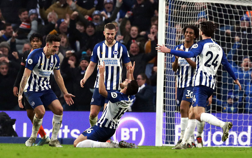 Brighton's Alireza Jahanbakhsh, centre, celebrates scoring his side's first goal of the game, during the English Premier League football match between Brighton and Chelsea at the AMEX Stadium, Brighton, England on Wednesday