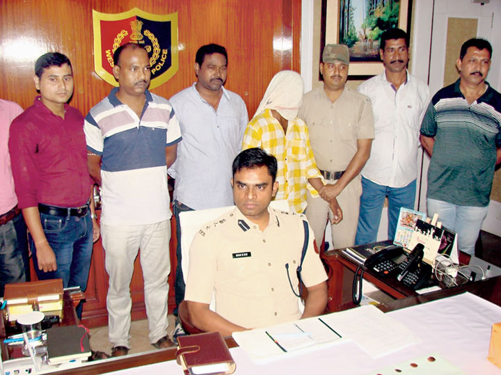 SP Mukesh with the accused at his office in Behrampore