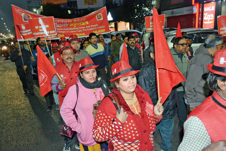 Bank and insurance company employees' march in Bistupur, Jamshedpur, on Tuesday.