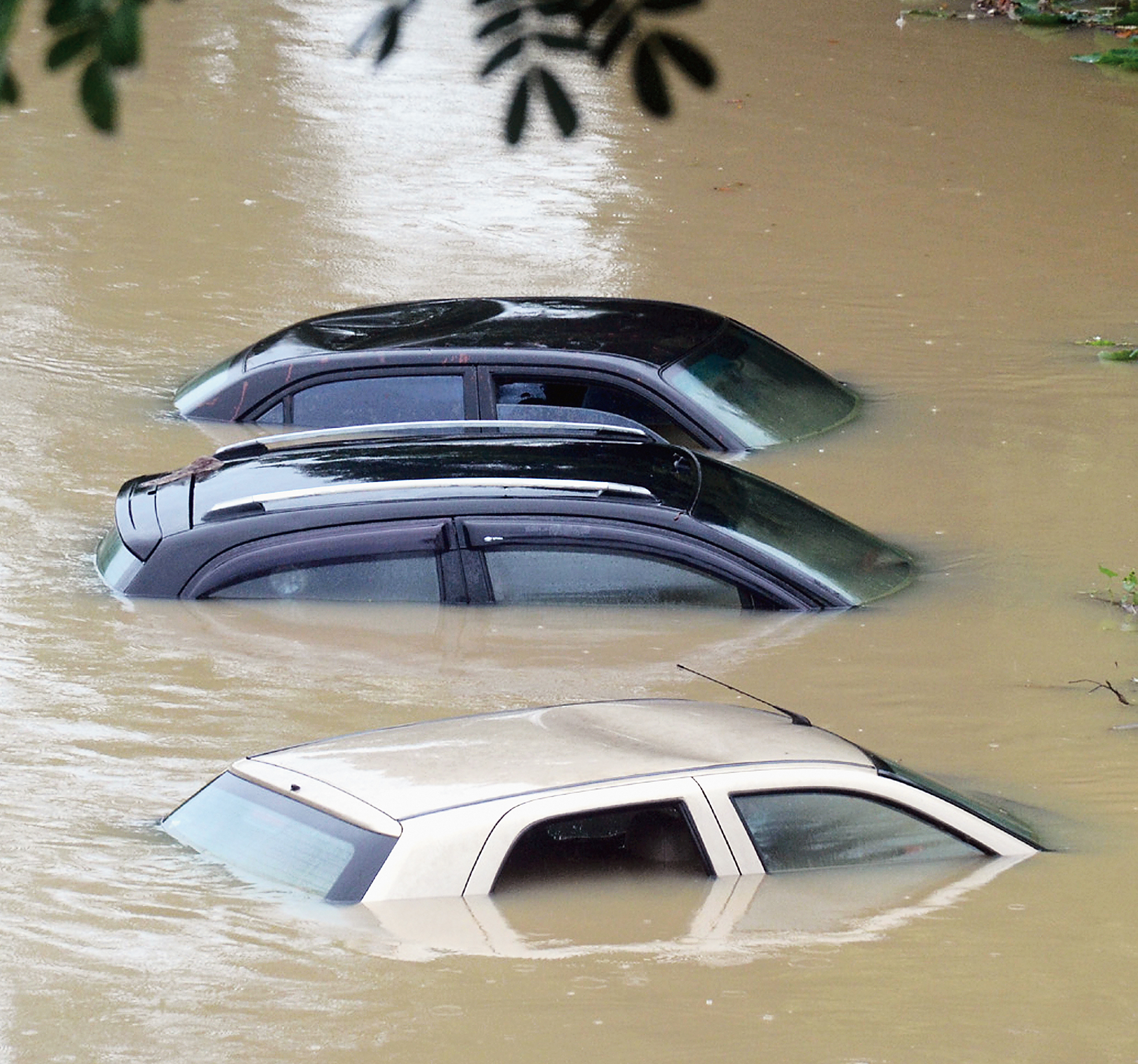 Cars submerged in floodwaters in Agartala on Sunday.