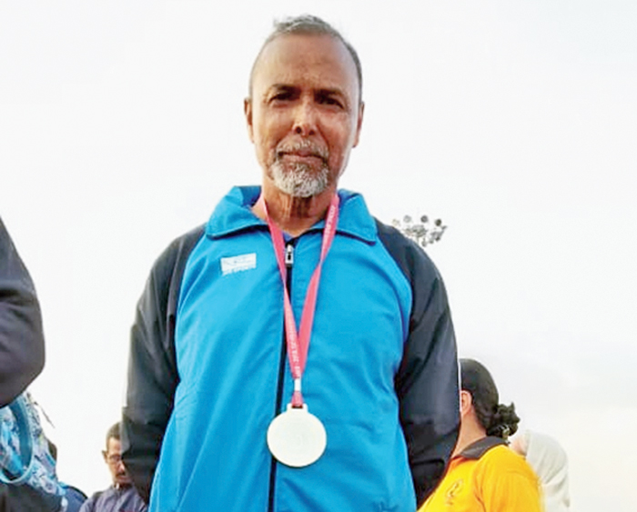 Achinto Pramanik with his silver medal