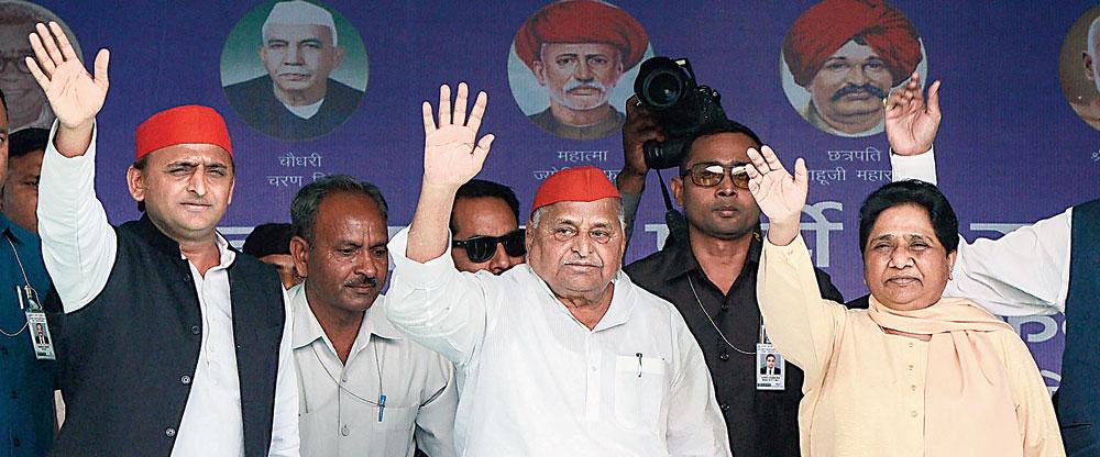 Akhilesh Yadav, father Mulayam Singh and Mayawati wave at the crowd at the rally