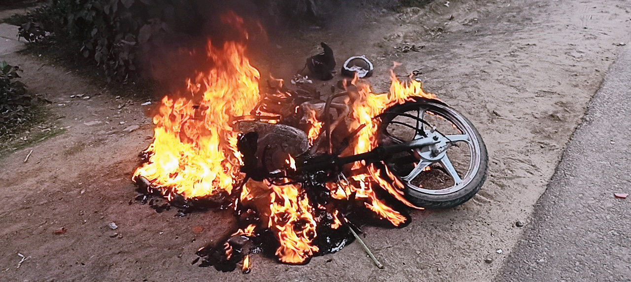 A motorcycle set on fire near a Trinamul office in Contai town.