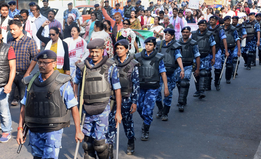 Rapid Action Force personnel keep vigil as activists of All Assam Students Union along with members of various organisations participate in Satyagraha procession demanding withdrawal of the Citizenship Act, in Guwahati, Tuesday, December 17, 2019.
