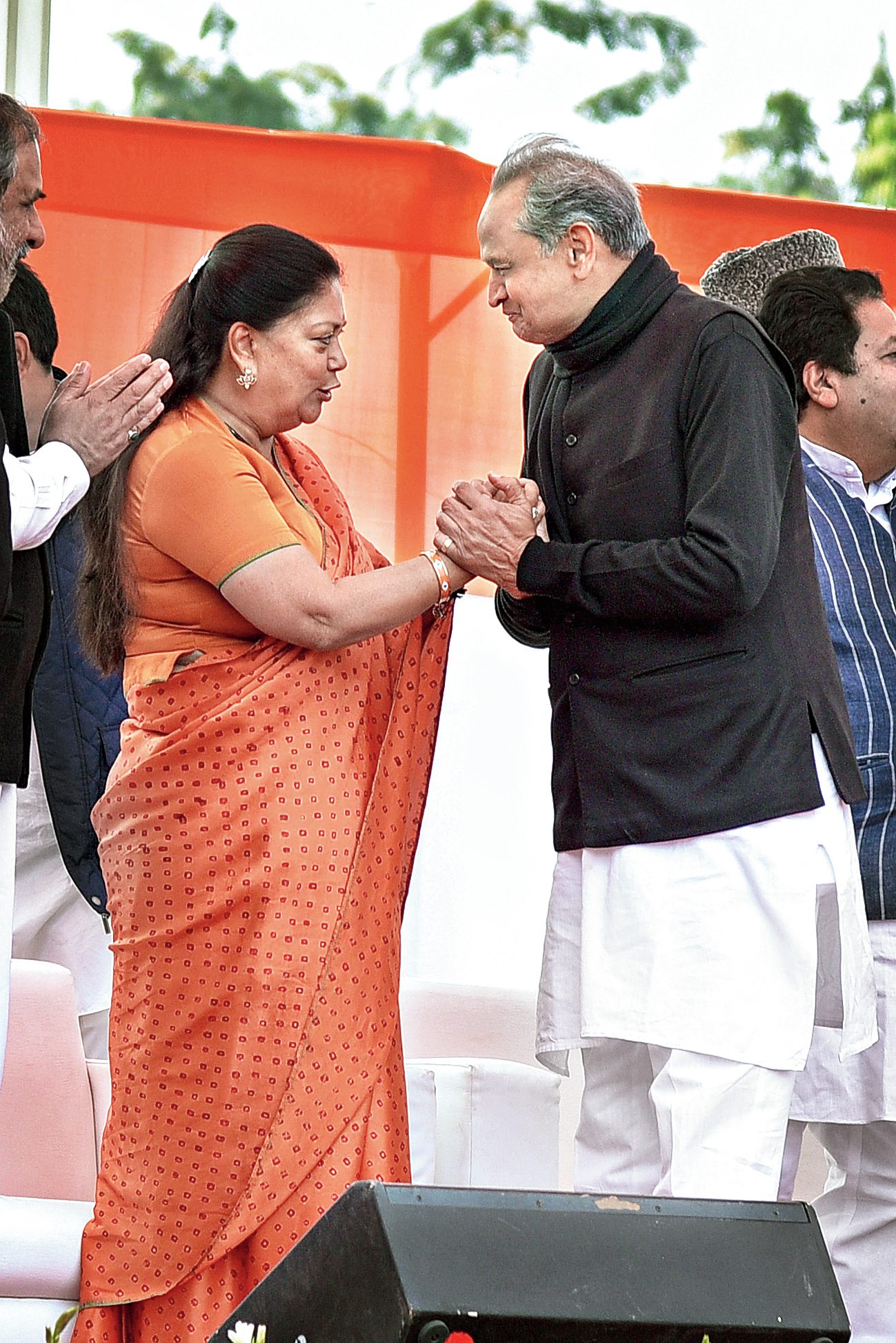 New Rajasthan chief minister Ashok Gehlot and his predecessor Vasundhara Raje greet each other in Jaipur.