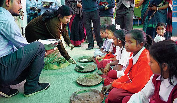 Birbhum DM Moumita Godara Basu serves meals on Monday.
