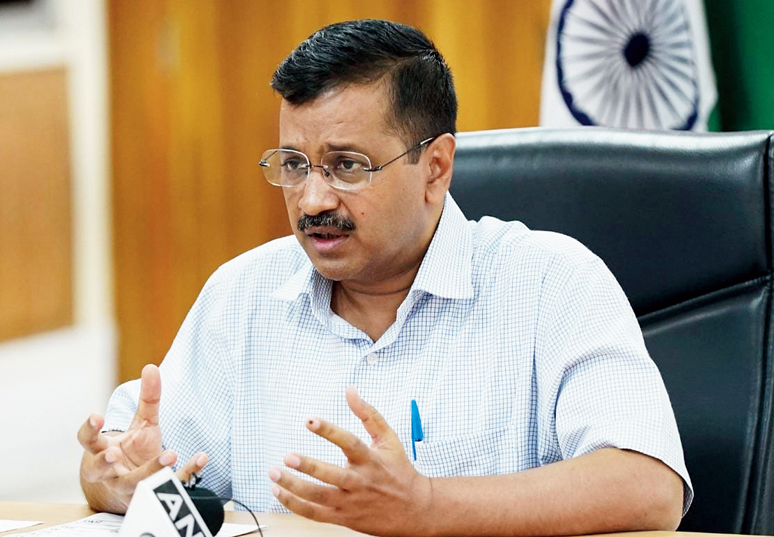 A Twitter image posted by Arvind Kejriwal shows him at a video conference in New Delhi on Tuesday.