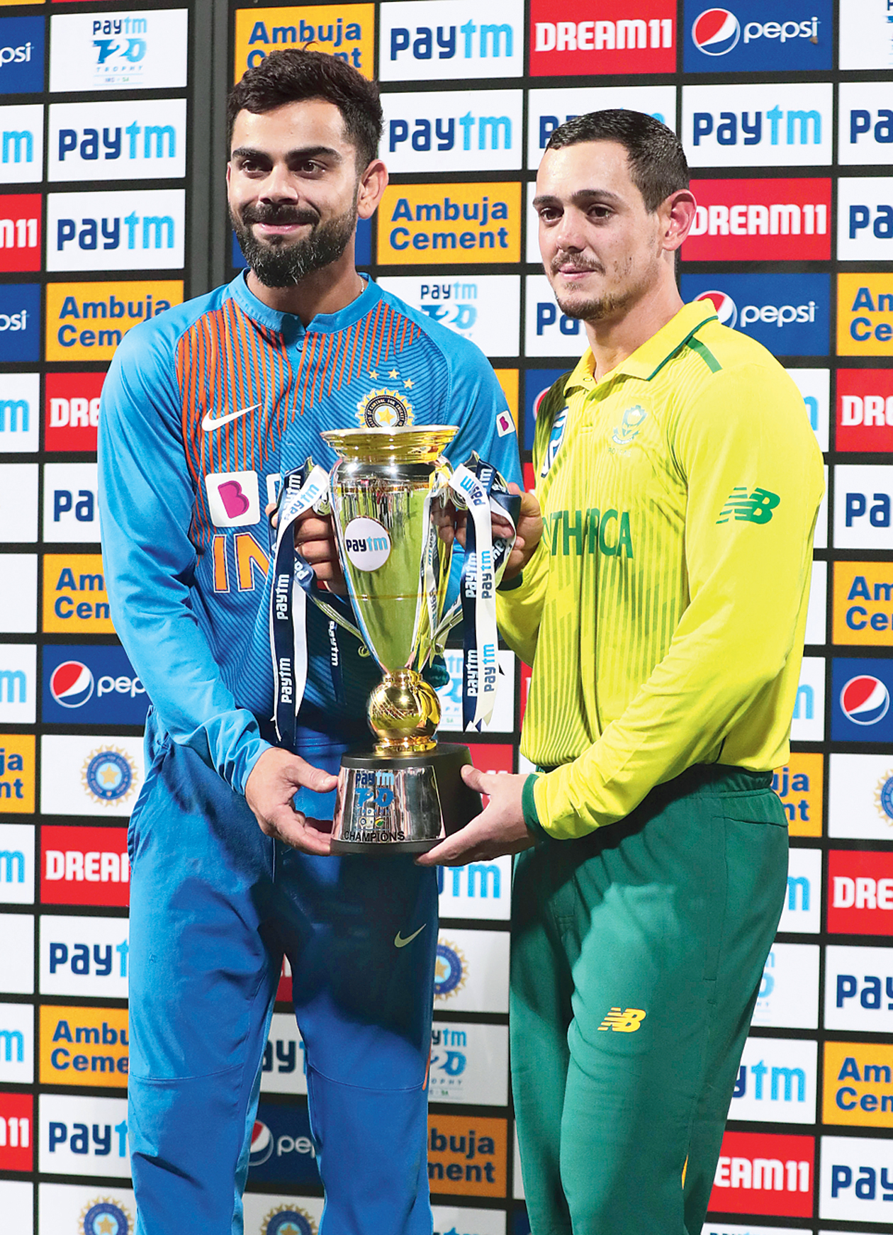 India captain Virat Kohli (left) with his South Africa counterpart Quinton de Kock in Bangalore on Sunday.