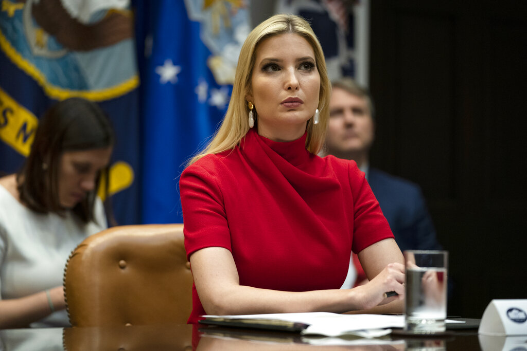 Ivanka Trump listens as President Donald Trump speaks during a conference call with banks