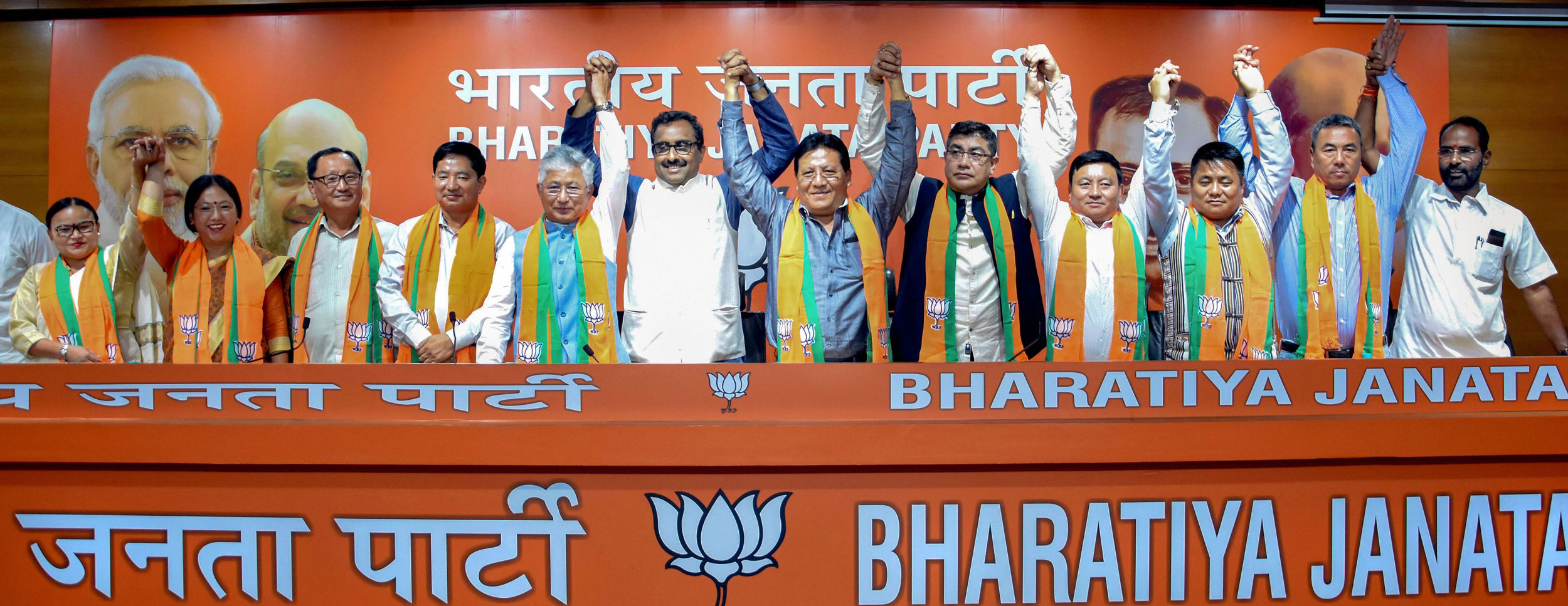 10 Sikkim Democratic Front MLAs join the BJP in presence of the party's national general secretary Ram Madhav in New Delhi on August 13, 2019.