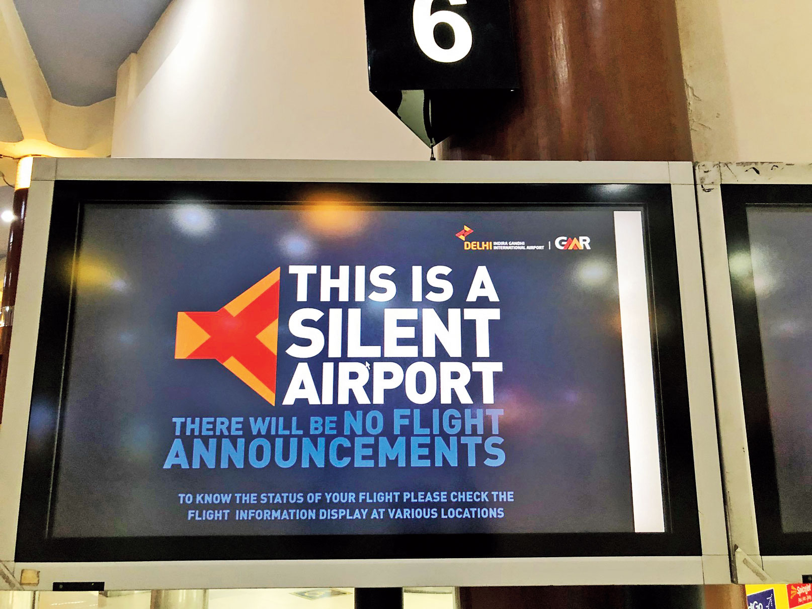 A display board announcing that New Delhi airport is a silent airport