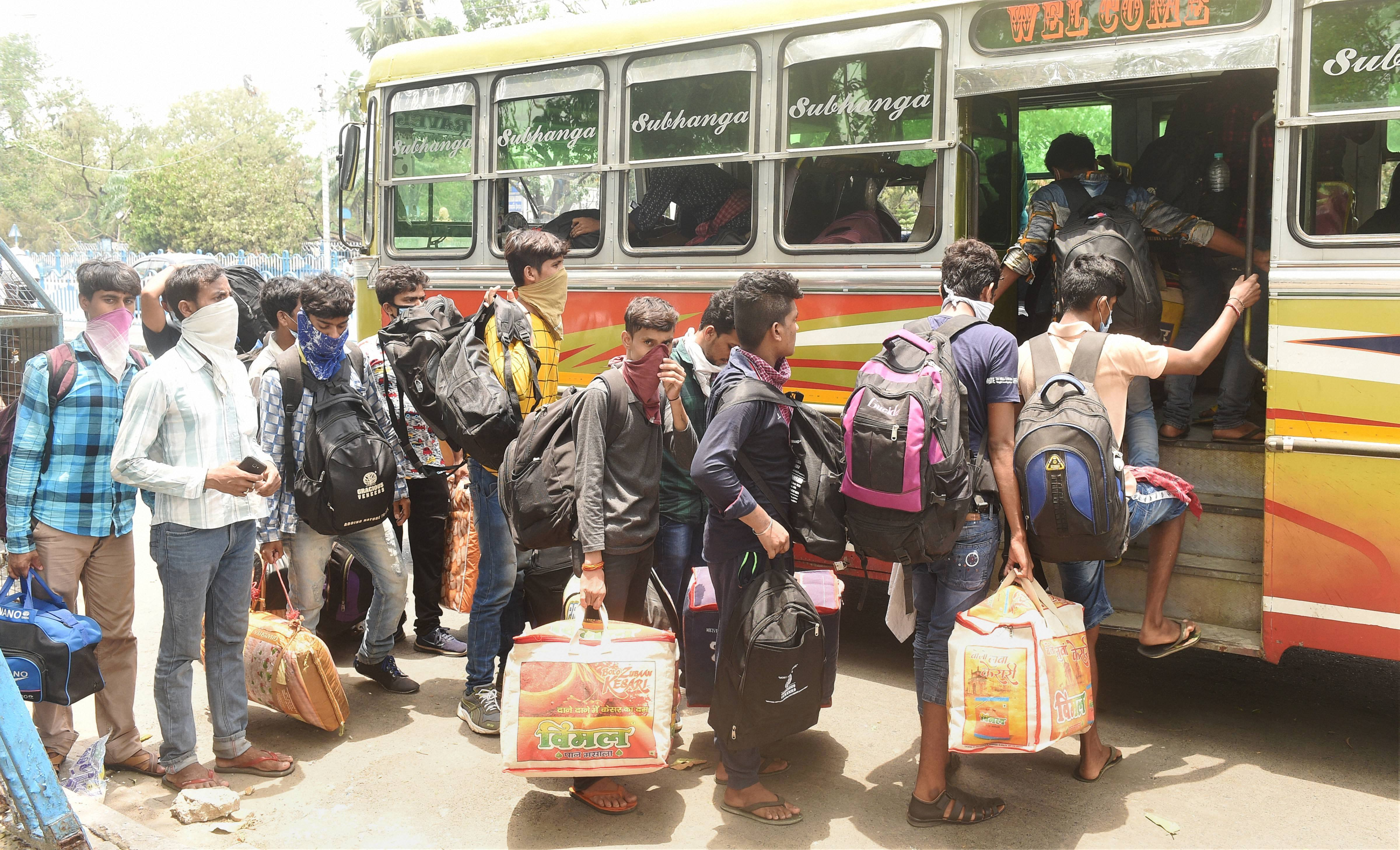 Migrants from Ahmedabad board a bus for South 24 Parganas, during the ongoing Covid-19 nationwide lockdown, in Calcutta, Wednesday, May 27, 2020.