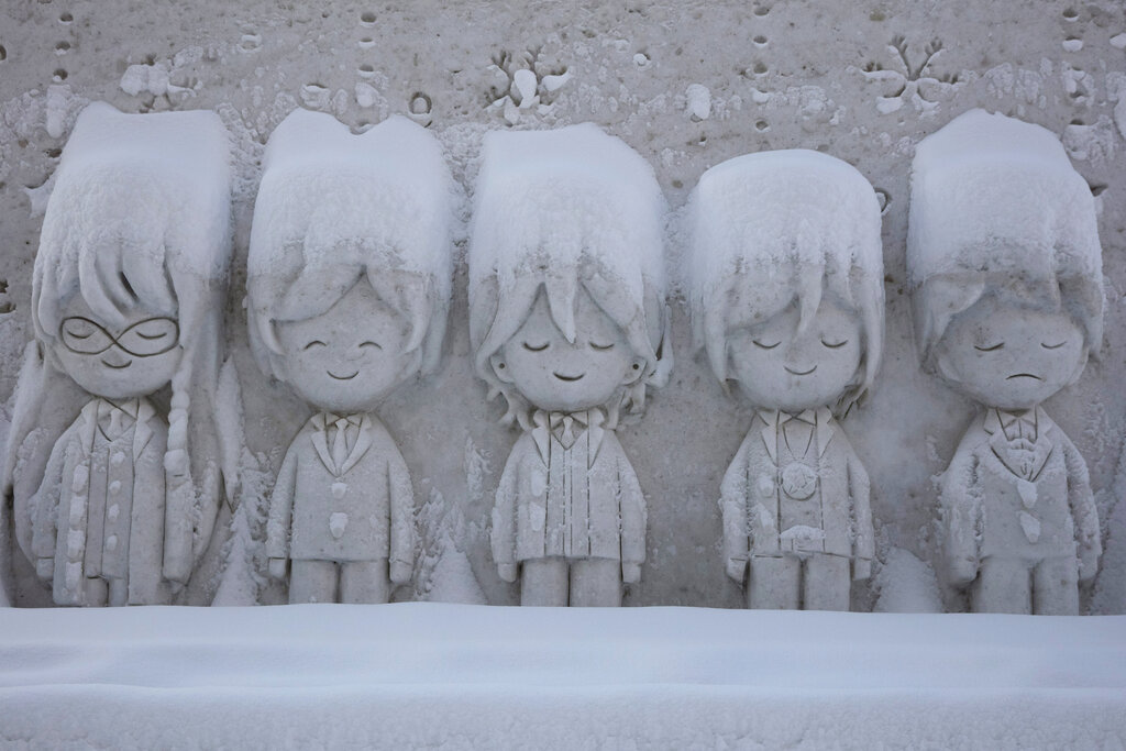 A snow sculpture is covered with fresh snow at the Sapporo Snow Festival
