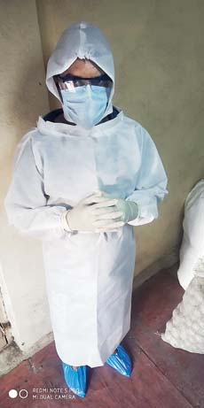 Deepesh Sharma in a PPE suit
