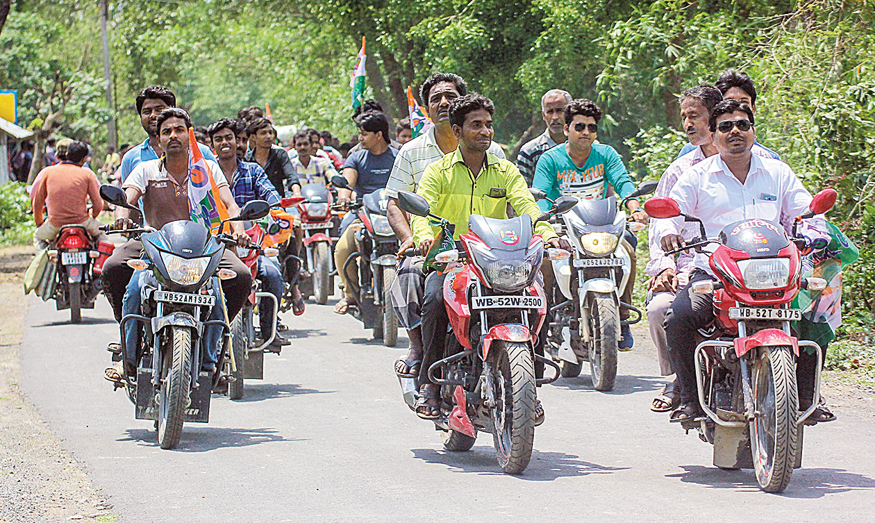 Trinamul supporters take out a motorcycle rally in Santipur. Alleged Trinamul workers who owed allegiance to Santipur party MLA Arindam Bhattacharjee pasted the posters