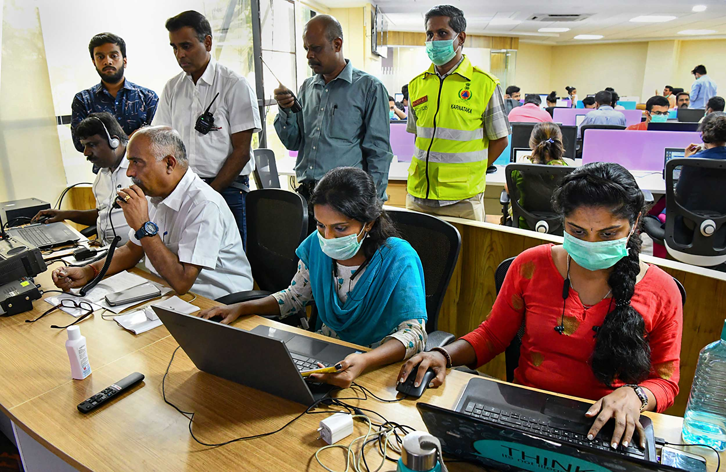 Officials work in the Karnataka Chief Minister's Covid-19 War Room at DIPR Building in Bangalore on Tuesday.