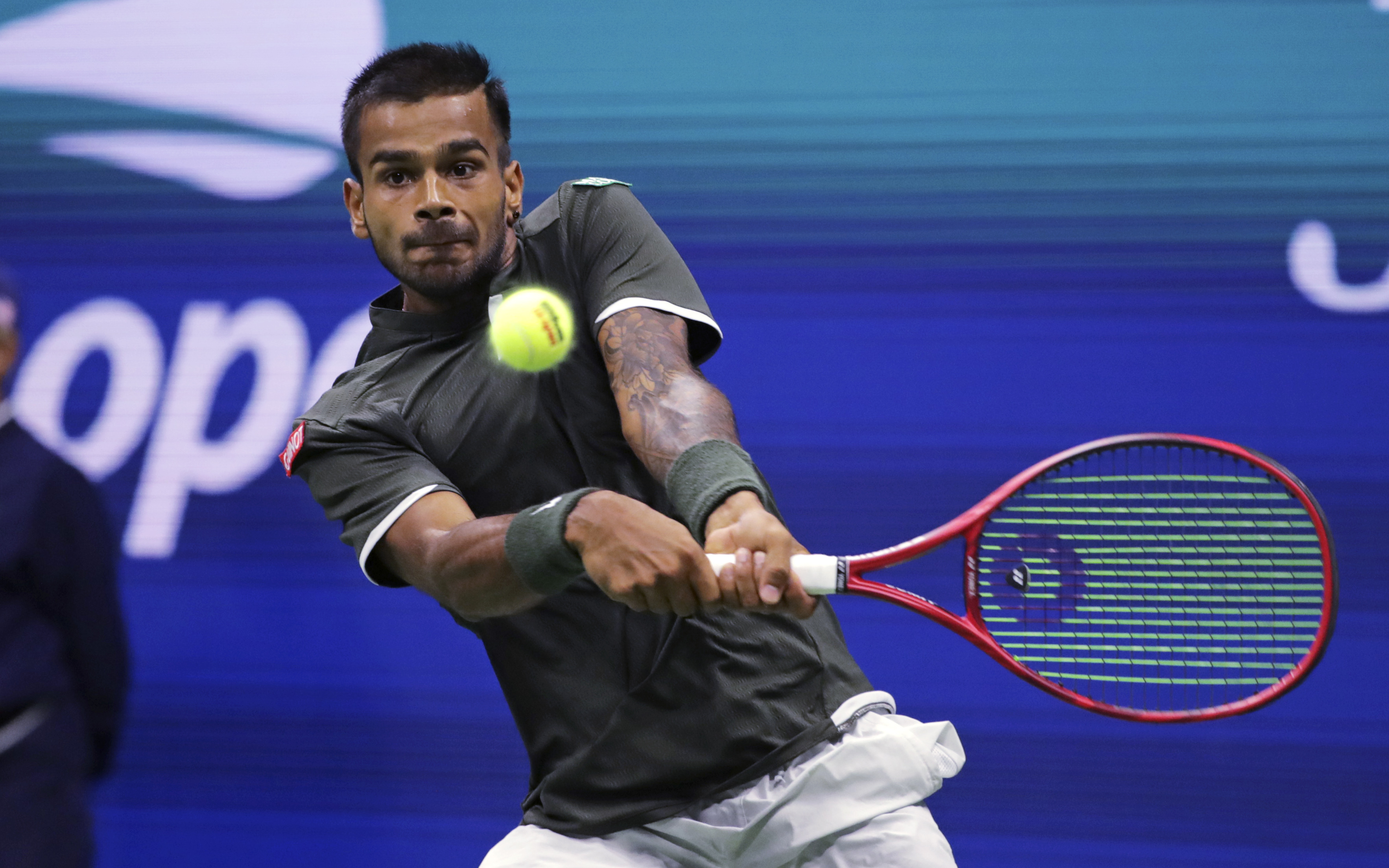 Sumit Nagal returns to Roger Federer during the first round of the US Open in New York.