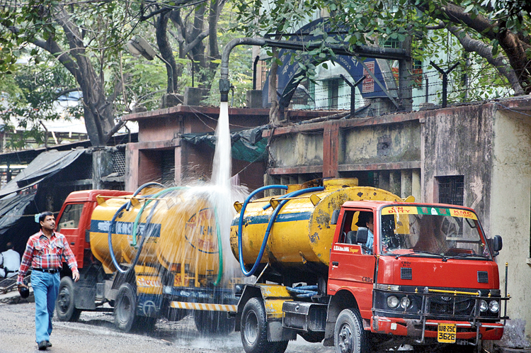 A file picture, clicked much before Covid-19 entered India, of Calcutta Municipal Corporation water tankers being filled up before distribution