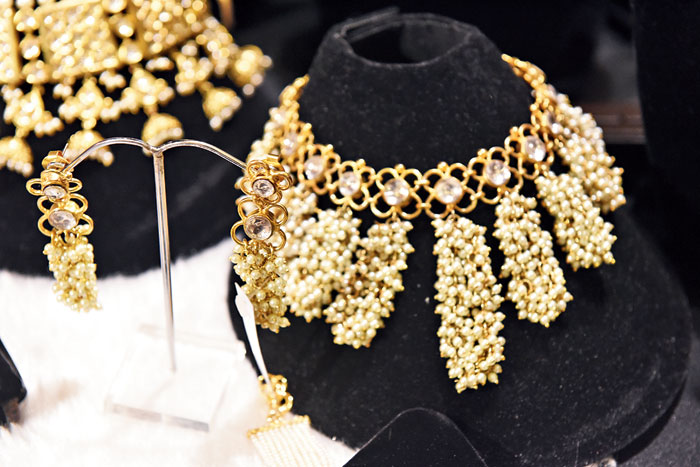 Accessorise your traditional sari for the Diwali evening with this statement reversible neckpiece and earrings set made of pearls and polkis. We love the cascading pattern. Rs 9,000 @Paraa(find them on Instagram @paraa_jewel_art)