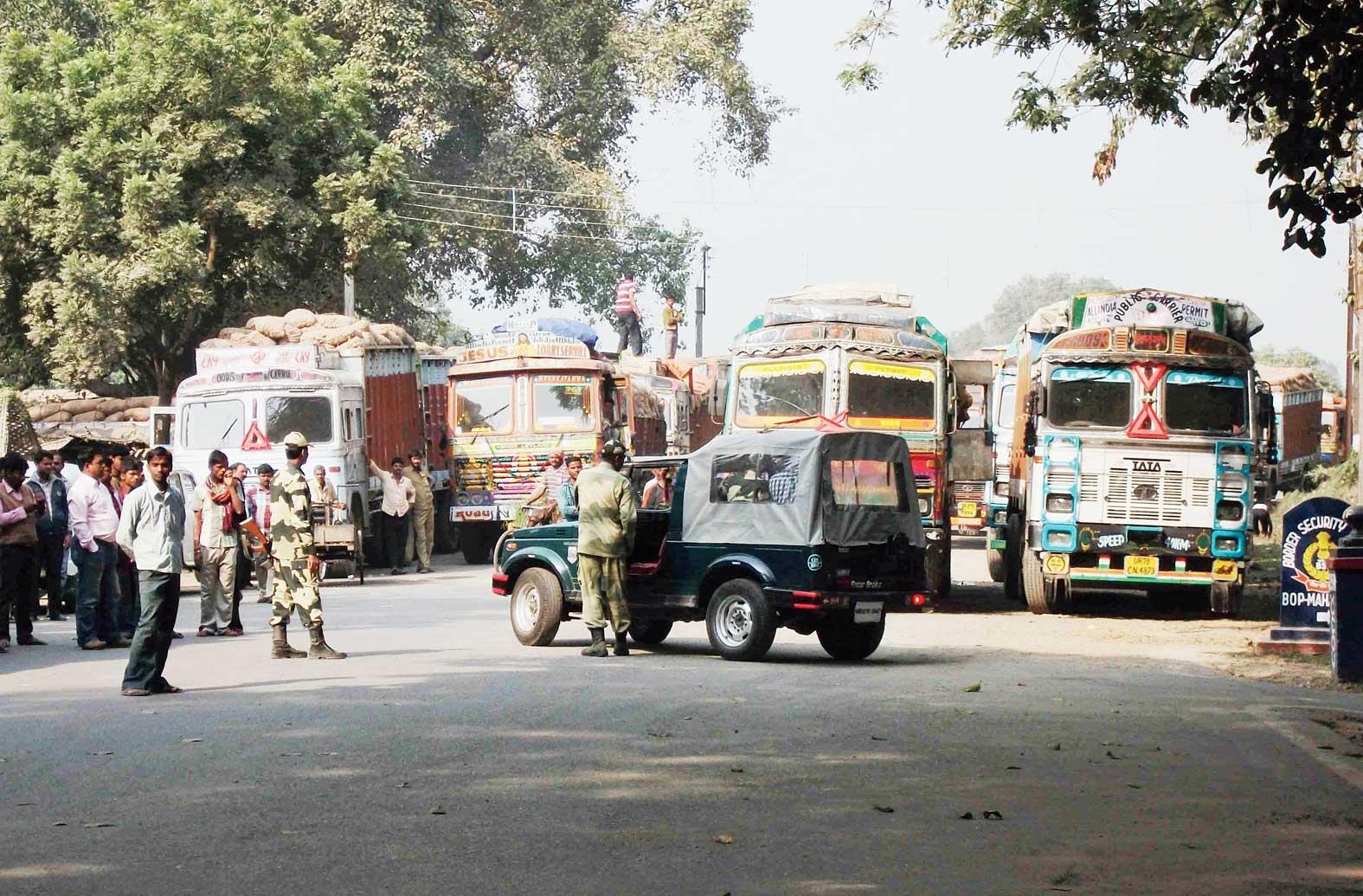 Trucks along the Bangladesh border at Mahadipur