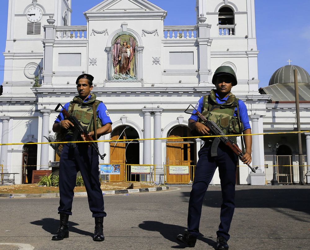 Sri Lankan Navy soldiers stand guard in front of the St. Anthony's Shrine a day after the series of blasts, in Colombo, Sri Lanka on Monday, April 22, 2019.
