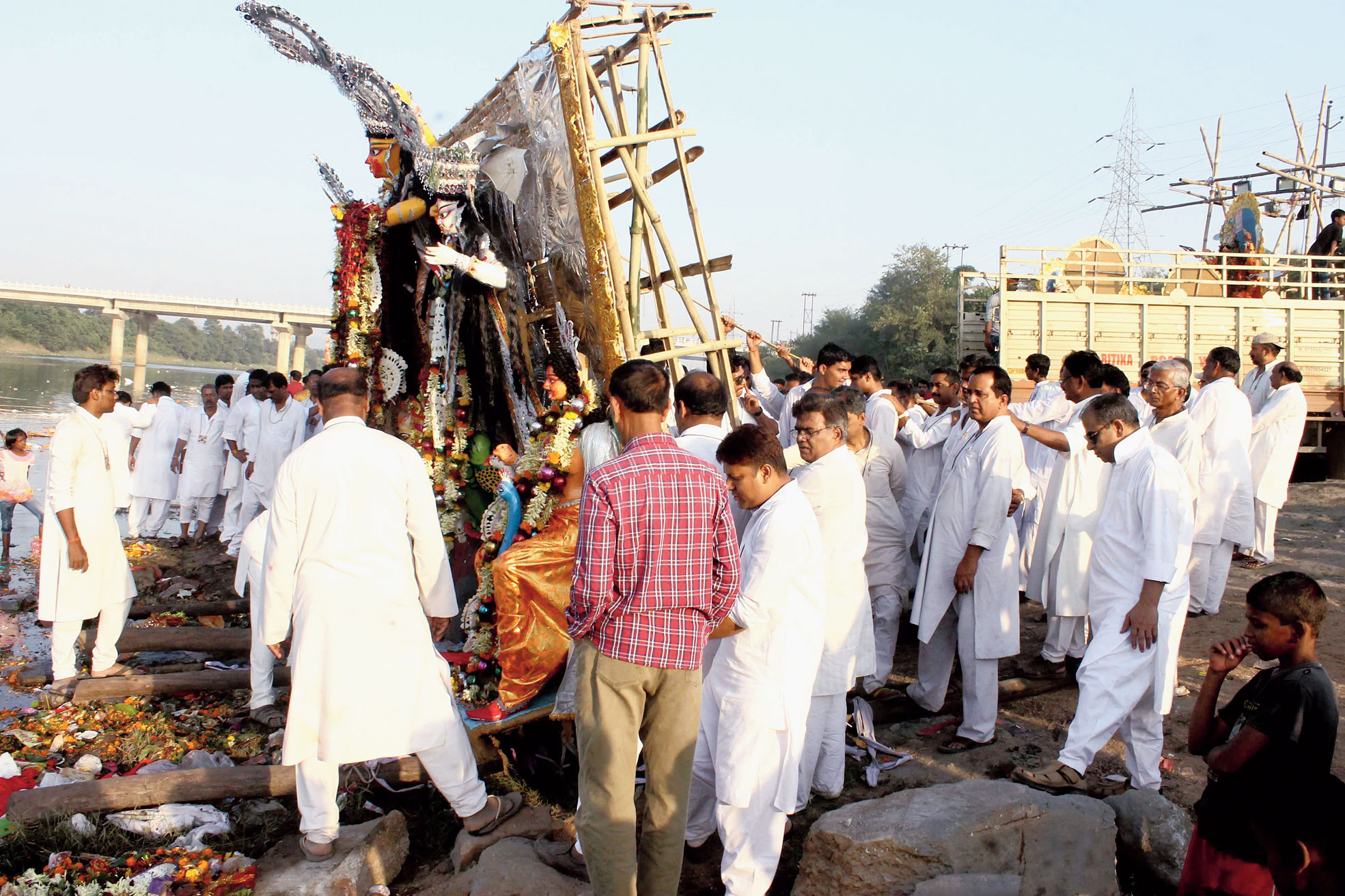Devotees immerse a Durga idol at the new Balu Ghat near Domuhani in Sonari, Jamshedpur, on Friday.
