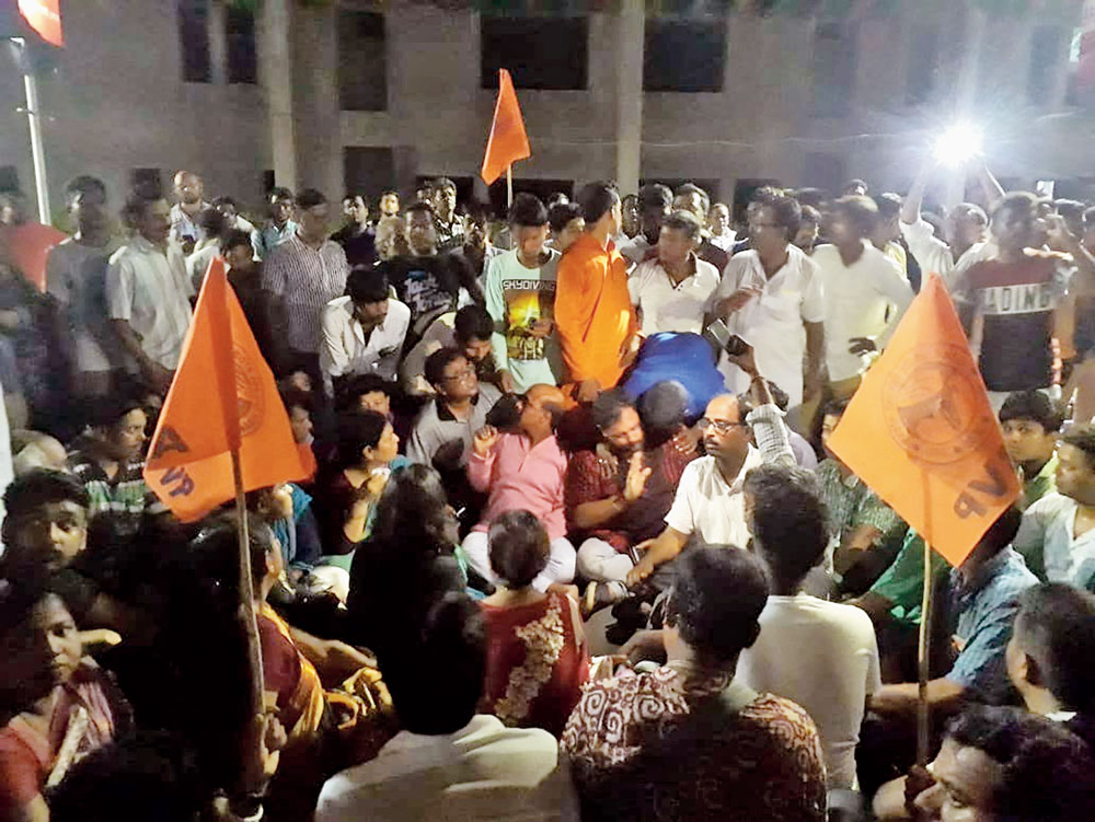 ABVP and BJP activists block a road in front of Kalyani police station on Friday