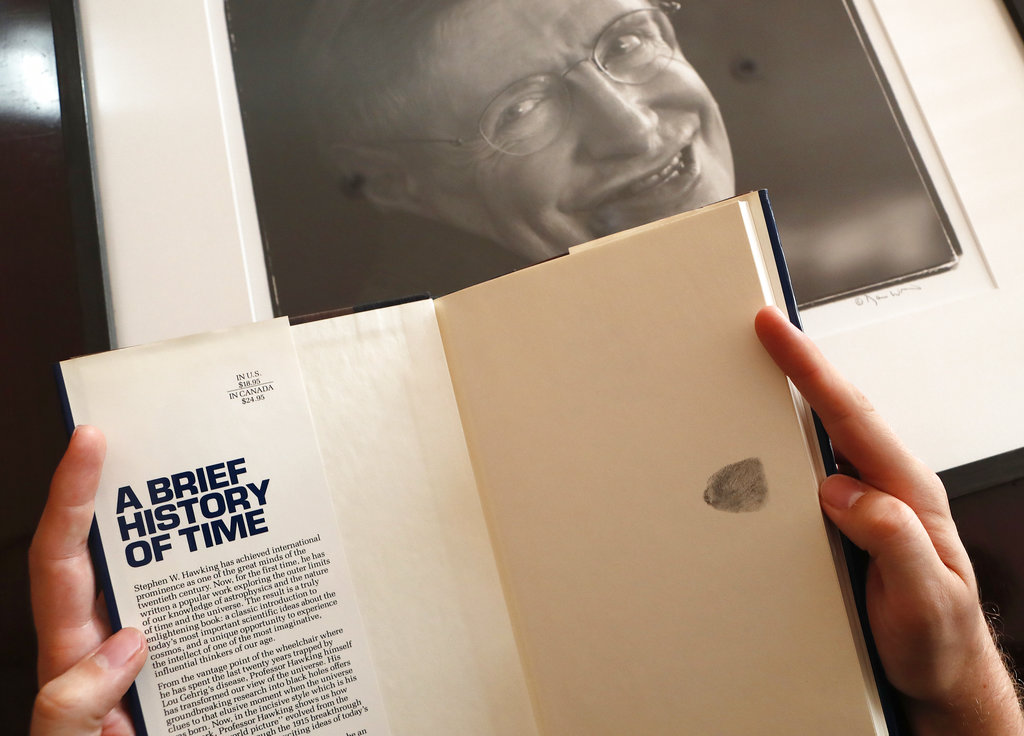 A copy of A Brief History of Time, signed with a thumb print by Stephen Hawking, that will go under the hammer.