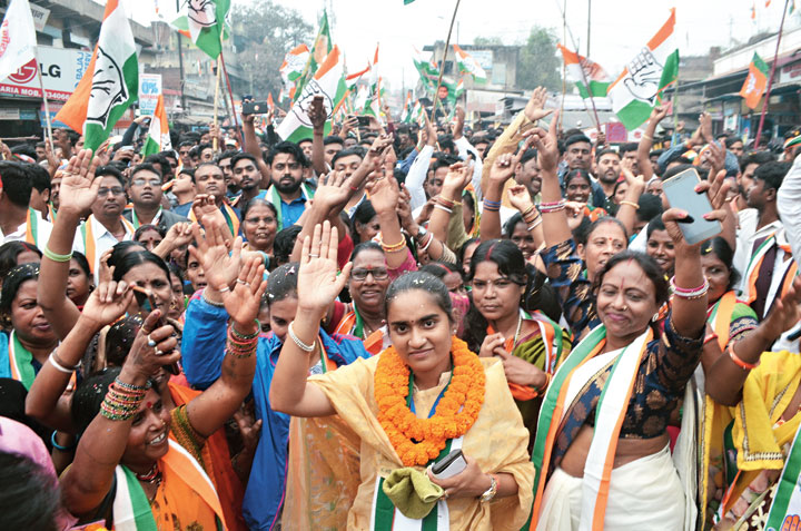 Congress candidate Purnima Singh (in yellow sari) campaigns in Dhanbad on Friday