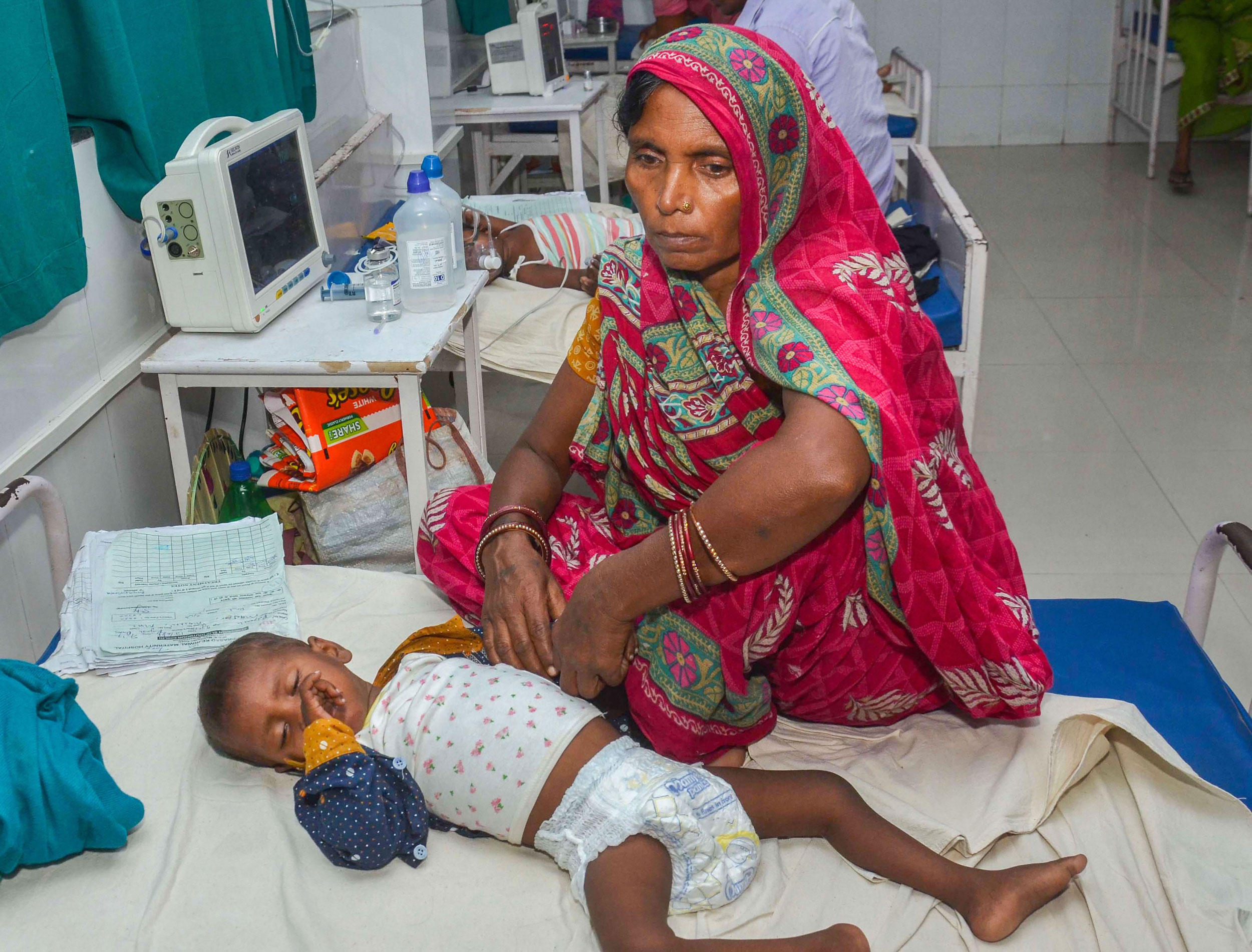 A child suffering from acute encephalitis syndrome being treated at a hospital in Muzaffarpur on June 22, 2019.