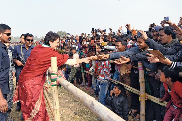 Priyanka Gandhi Vadra greets people during the election rally at Barharwa block in Sahebganj district on Wednesday.
