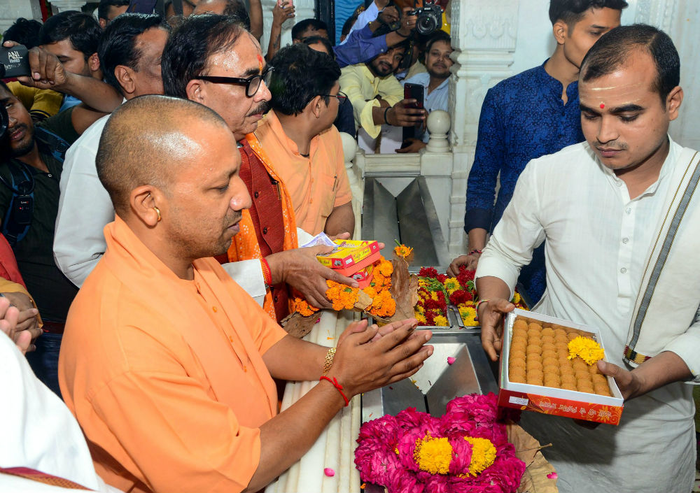 Chief minister Yogi Aditiynath offers prayers at a temple in Lucknow on Tuesday