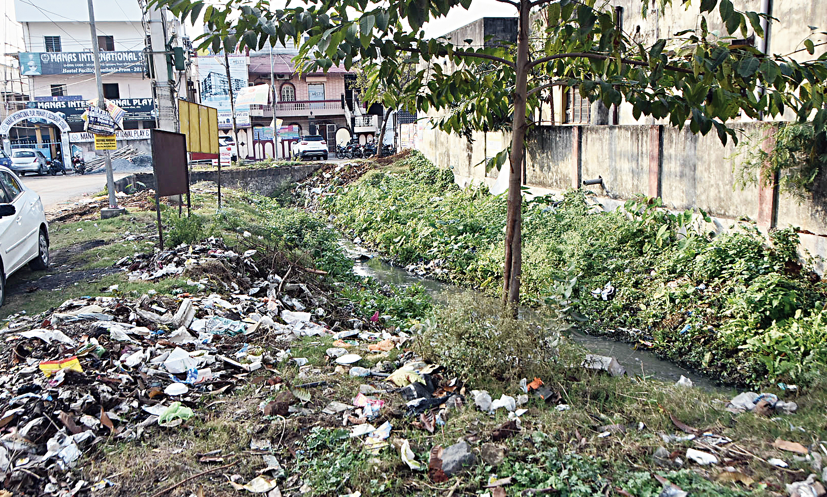 A garbage dump and uncleaned drain at Housing Colony in Dhanbad on Friday.