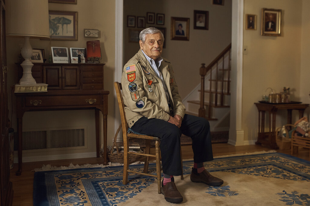 World War II US veteran Frank DeVita, who took part in the D-Day battle poses for a picture at his home in Bridgewater, New Jersey, May 14. This June he'll make his 12th trip back to Normandy. He likes to bring people with him so they'll know what happened there.