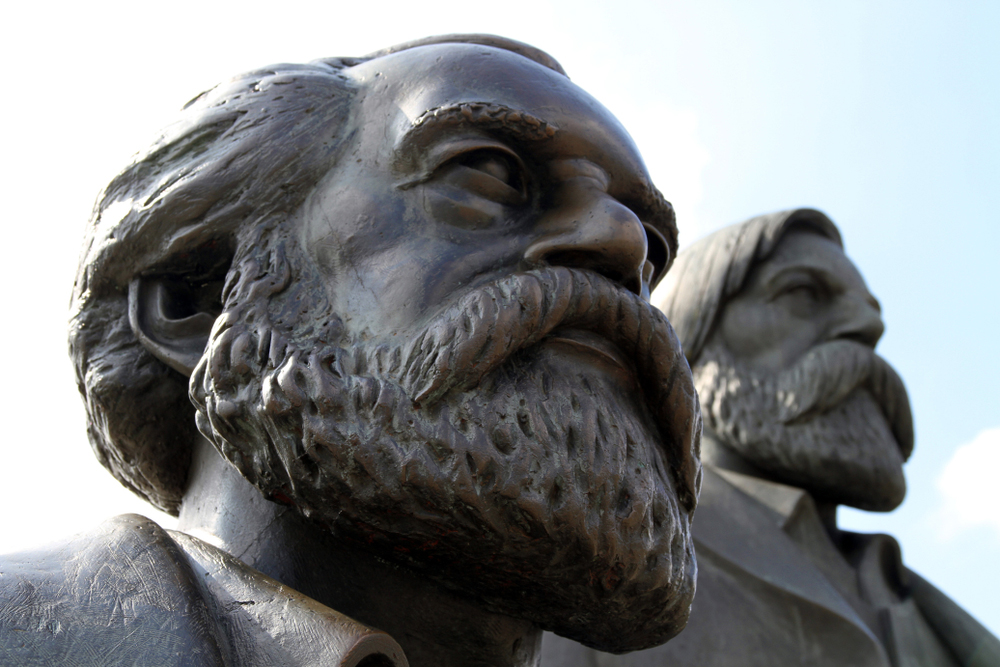 Karl Marx and Friedrich Engels monument in the park of the central district of Berlin, Germany.