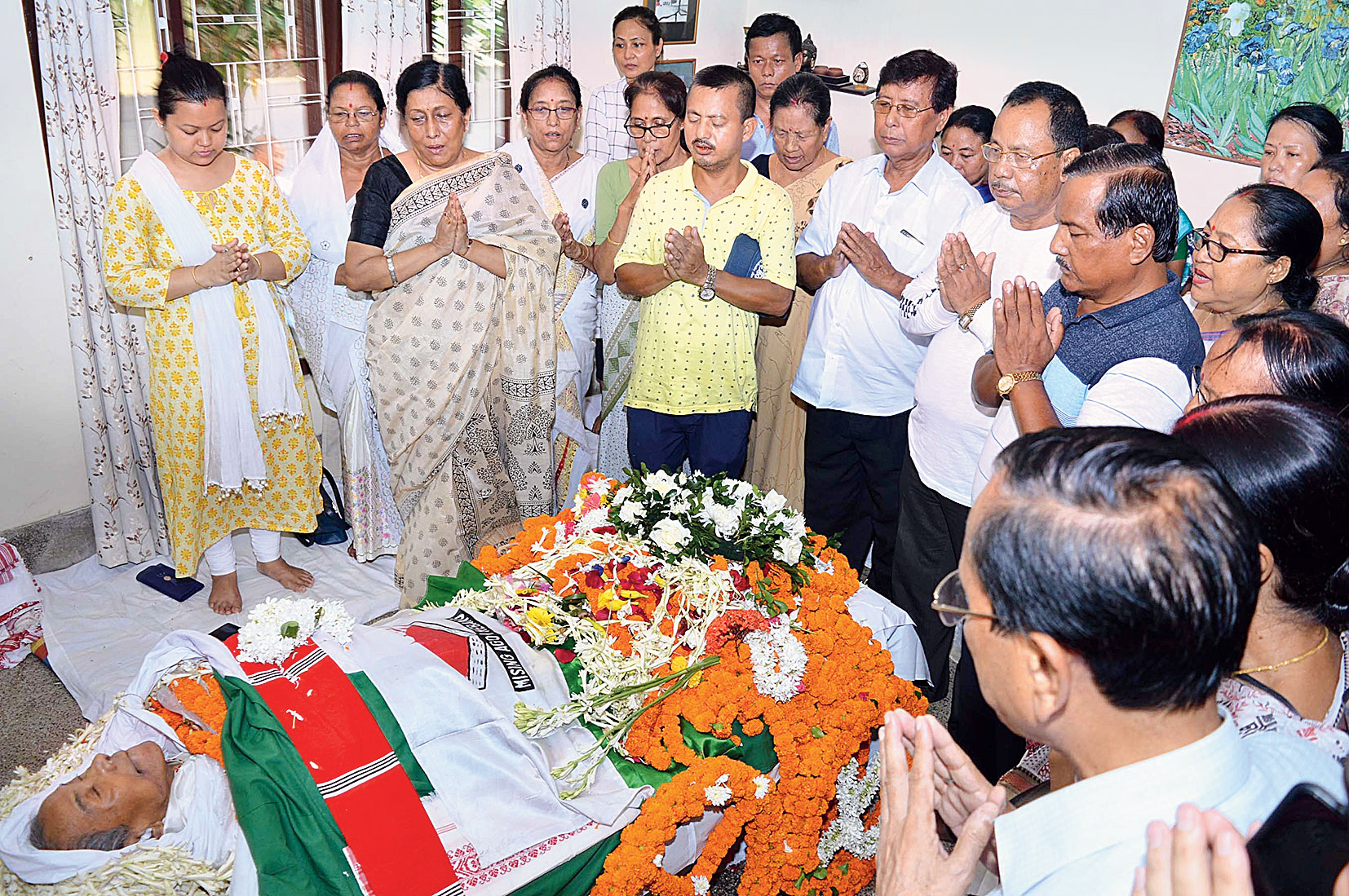 Family members and well-wishers pay tribute to Tabu Ram Taid at his residence in Guwahati on Saturday.