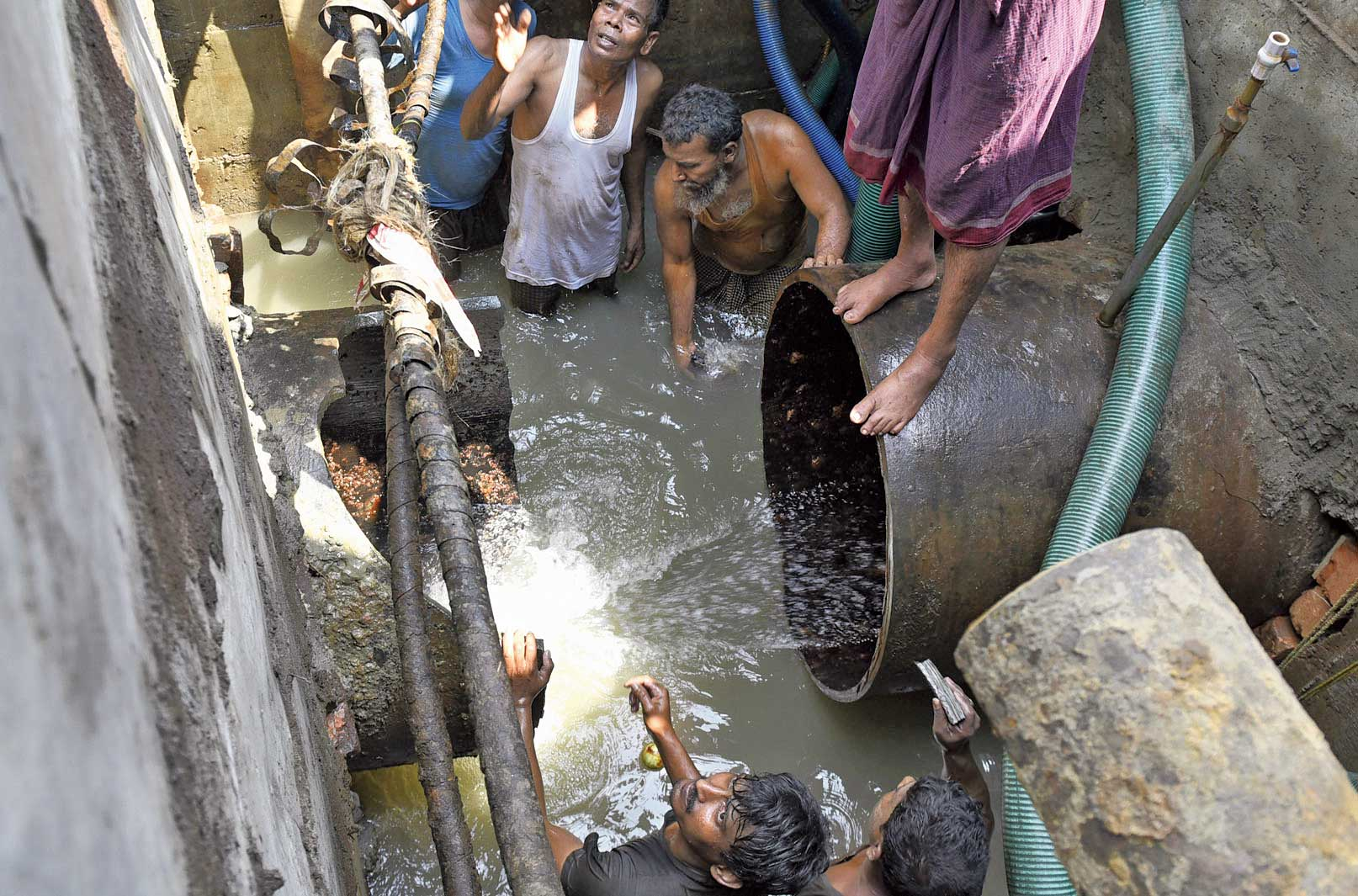 A water pipe under Lenin Sarani that was cut for an evacuation shaft to be built for the East-West Metro line on Saturday.