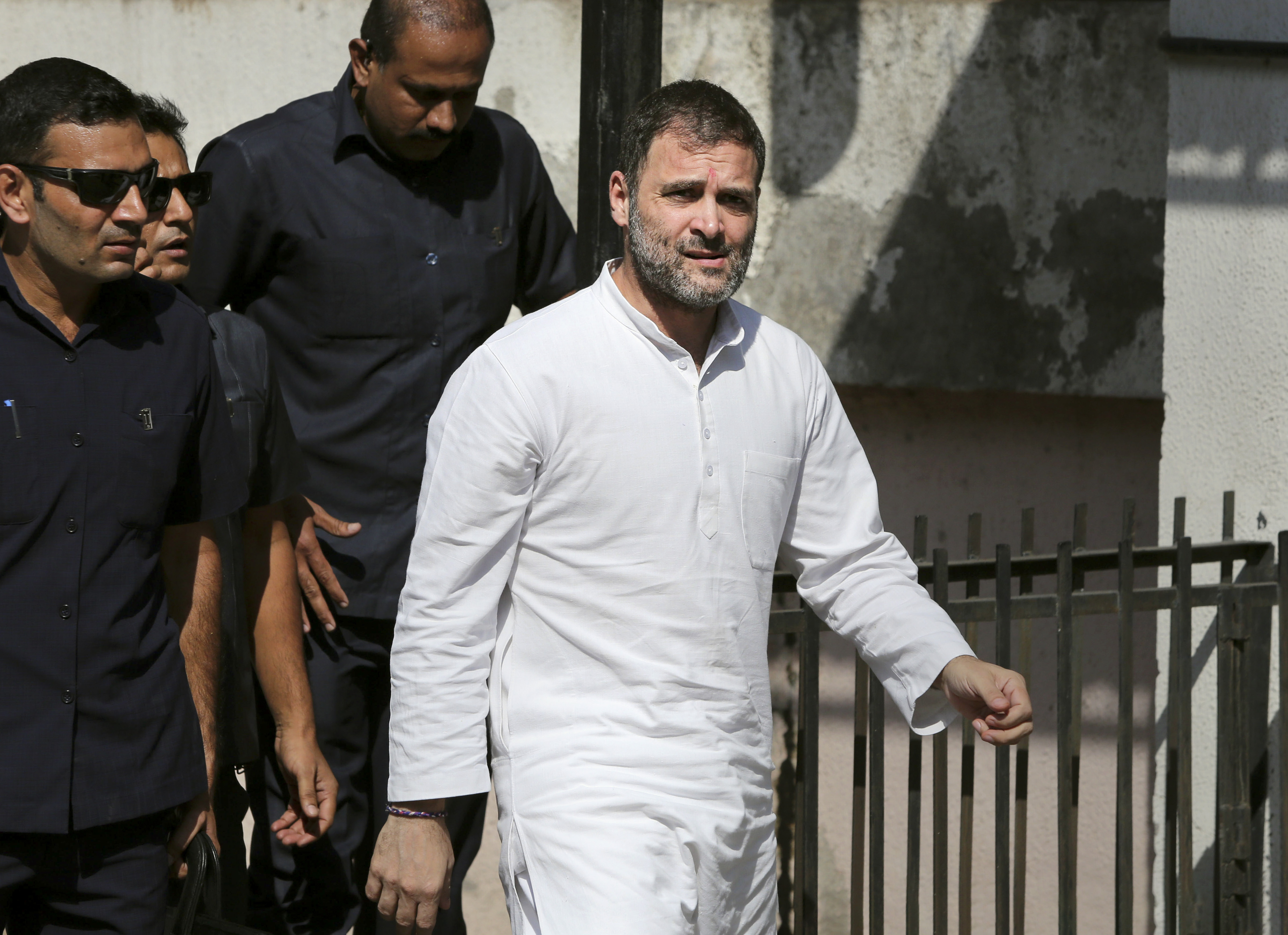 Congress leader Rahul Gandhi arrives in a local court in connection with two criminal defamation suits filed against him, in Ahmedabad, Friday, October 11, 2019