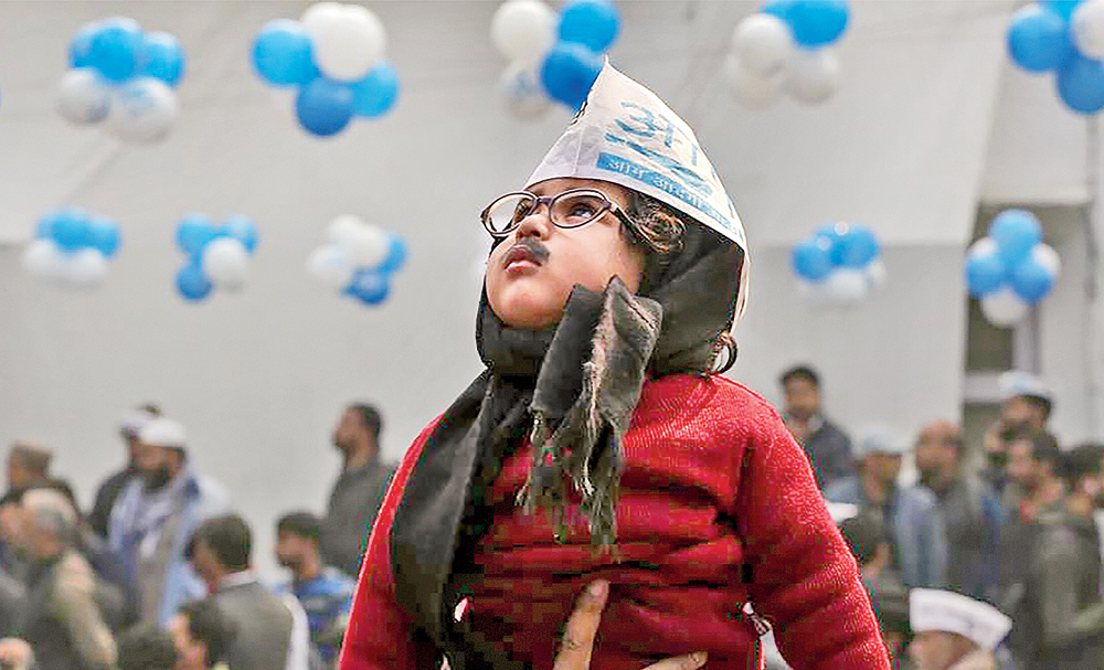 A child dressed as AAP convener Arvind Kejriwal at the party headquarters in New Delhi on Tuesday